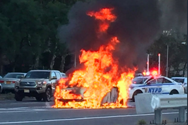 A car burst into flames in the southbound lane of the FDR Drive near East 116th Street Tuesday evening, Oct. 17, 2017.