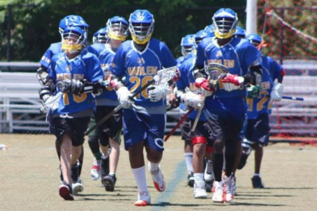 Boys from HLL's P.S. 149 Program warm up before the Spring 2015 Harlem Bowl on Randall's Island. Harlem Lacrosse. (photo by Louie Sawi)