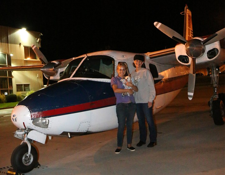Winston with Sarah (pilot) and foster mom, Mary.