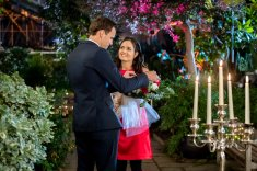 Helen works in a flower shop and her best friend Henry at the botanical gardens. At a masquerade gala, she thinks a masked man is Henry but he's actually off working. Enchanted by the dashing stranger, Helen is disappointed when he abruptly races off, dropping his rose boutonniere. Love-struck, she recognizes the rose, finds the buyer and they begin dating, until Helen finds out he has plans to turn the botanical gardens into condos. Meanwhile, Henry takes off, sure that Helen loves another man. He's always wanted more than friendship, but when Helen finally admits she does too, Henry is already gone. Finding solace in her work, Helen is asked to deliver flowers to someone and is met with the most romantic surprise of her life. Photo: Credit: Copyright 2018 Crown Media United States LLC/Photographer: Shane Mahood
