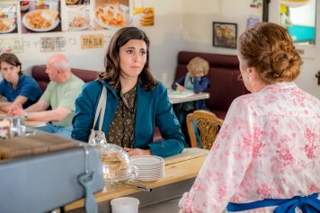 When Oliver O'Toole and his team of postal detectives discover a secret room containing an undelivered package next to the Dead Letter Office, they take on the challenge of completing its delivery with their usual fervor, but soon discover that the senders are at risk of losing their family farm unless the POstables can locate a globe-hopping family member before the auction gavel falls. Photo: Jamie-Lynn Sigler, Christian Convery, Marilyn Norry Credit: Copyright 2018 Crown Media United States LLC/Photographer: David Strongman