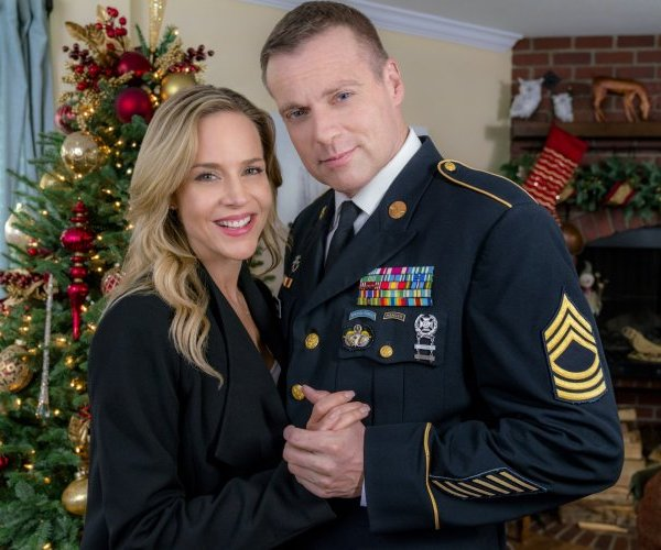 A Couple Embrace In Christmas Homecoming Hallmark Channel