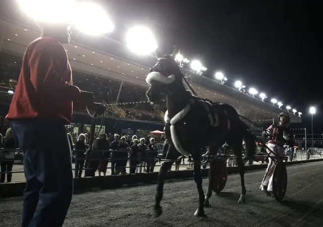 Trainer Clyde Francis (left) and driver Montrell Teague head for the winner's circle at Mohawk after winning the $616,000 Canadian Pacing Derby gate-to-wire.   New Image Media