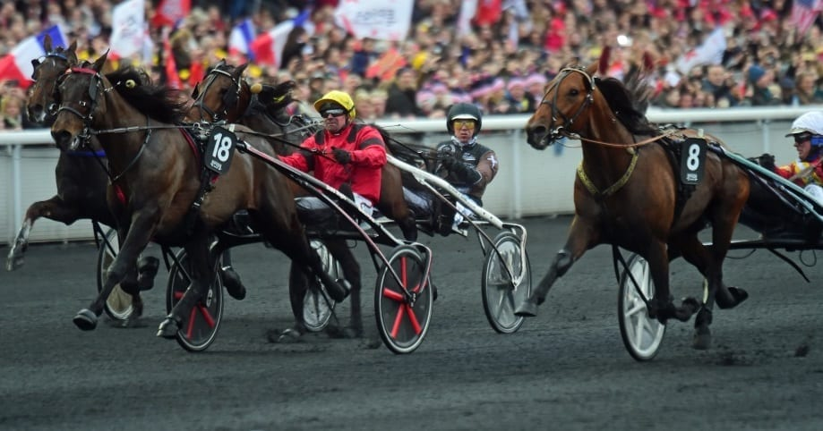 Readly Express (8, Björn Goop) held off two-time defending Prix d'Amérique champ Bold Eagle (18, Franck Nivard) and Propulsion (Örjan Kihlström, black helmet) to win the $1.24 million classic Sunday afternoon at Vincennes | Gerard Forni