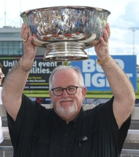 "Claus Andersen | Atlanta's co-owner Brad Grant said it felt ""pretty damn good"" to raise the Hambletonian trophy."