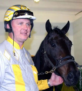 Mike Lizzi | Trainer and part-owner Ron Burke and Foiled Again.