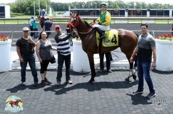 Coady Photography | On June 28, trainer Chris Banks (far right) posted a unique Illinois double winning with thoroughbred Sperling at Arlington International Racecourse (above) and then at Hawthorne Race Course that night with Vegas Bomb.