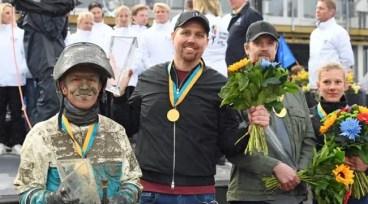Gerard Forni | Örjan Kihlström (left) joined trainer Daniel Redén (center) in the Olympiatravet winner's circle.