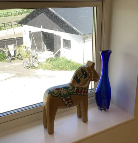 A Swedish Dala horse in the window.