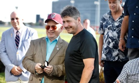 Dave Landry | Forbidden Trade's trainer Luc Blais (black shirt) receives his Hambletonian ring from Doug McIntosh, trainer of 2000 Hambletonian champion Yankee Paco.