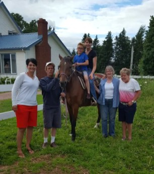 "Courtesy Jeff Lilley | PEI horseman Jeff Lilley and family with Kendal Python (p, 5, 1:58.4h; $58,468), a 25-year-old ""lawn ornament"" with 494 lifetime starts, the most in North America when he retired."