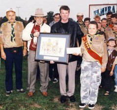 Kelly Spencer | The late Dr. Ted Clarke (second from left) presents driver Randy Waples with a thank you gift after Waples donated his $5,000 earnings from his 1999 Battle of Waterloo victory with Your Nemesis to the local chapter of the Boy Scouts.