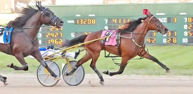 Brad Conrad | Two-year-old trotting filly Merry Ann was one of two OHSS Final winners for trainer Ron Burke and driver Chris Page.