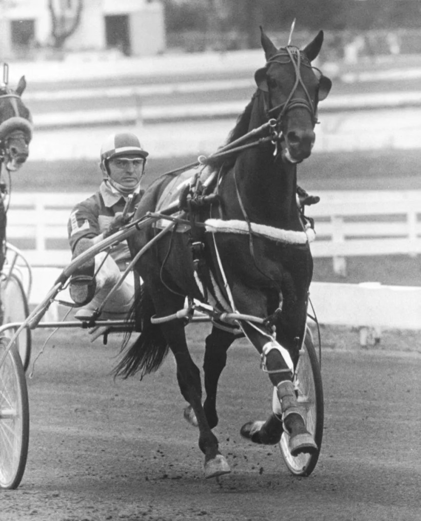 Escort (shown with trainer/driver Carl LeCause) won the inaugural Meadowlands Pace in 1977.