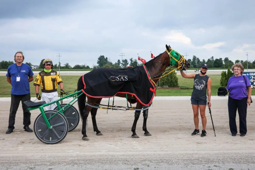 Tiffany Chantel Photography | OSAS 25th anniversary race winner Watch Me Dance and Trevor Henry at Grand River Raceway on Aug. 18.