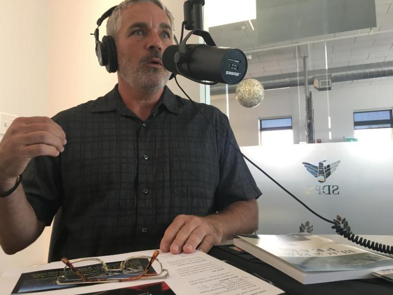 Author Bradley Saum being interviewed by Lori Walsh for her In the Moment radio program on South Dakota Public Broadcasting. /photo by Chynna Lockett/
