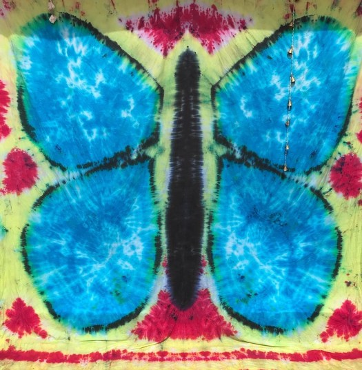 """Handmade blue morpho butterfly tapestry on 90"""" x 106"""" cotton/poly blend fabric using procion dyes."""