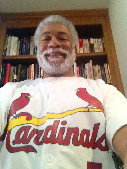 Harold Michael Harvey is a baseball fan in search of a team to root on to victory after his beloved Atlanta Braves decided to move out of downtown Atlanta. Here he sports a St. Louis Cardnial jersey. Photo Credit: Cascade Publishing House