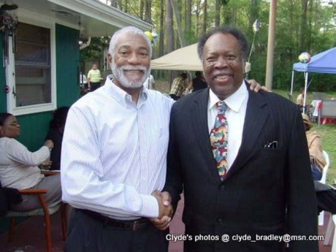 Harold Michael Harvey wishing A. Reginald Eaves a Happy 77th Birthday at a party hosted by Eaves good friend and supporter Julia Brown.