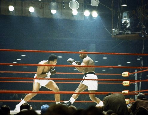 (L) Cassius Clay (R) Sonny Liston fighting for the Heavyweight Championship of the World on February 25, 1964. Clay won and immediately changed his name to Muhammad Ali. Photo Credits: AP Archives