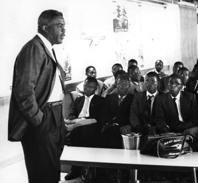 Jackie Robinson believed it was important to mentor young black men. He is pictured here lecturing a group on his experiences in the business community.