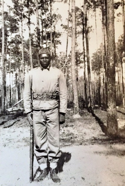 Frank Johnson standing at attention at the Marine training facility at Montford Point, South Carolina. Circa 1940s From the Frank Johnson Collection
