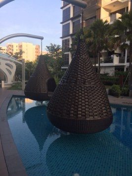 Cool basket chairs hung over the swimming pool in Singapore