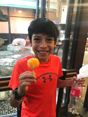 John enjoys a frozen tangerine on a stick