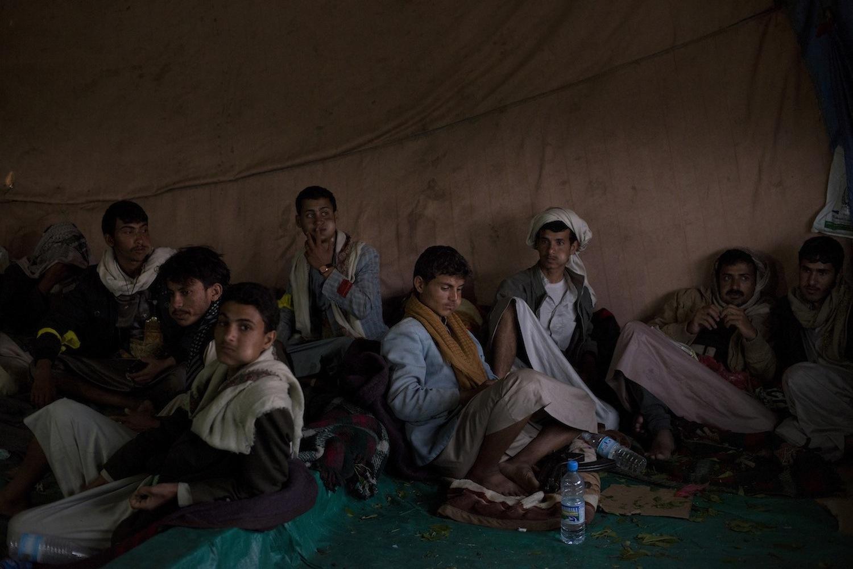 Yemeni tribesmen chew khat, a mild stimulant leaf used daily by many people in Yemen.