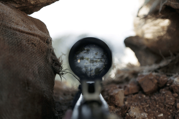 The view through the scope of a weapon that belongs to a member of Ahrar al-Sham, Idlib, Syria, March 2015 © Khalil Ashawi/Reuters