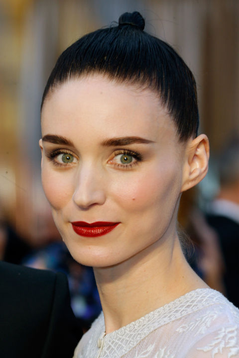 The actress sported her red-carpet-signature burgundy lipstick and a sleek up-do.