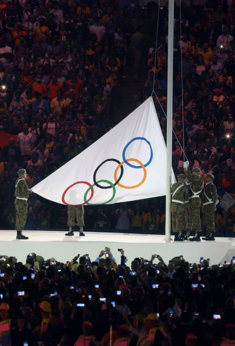 Opening ceremony: The Olympic flag is raised.