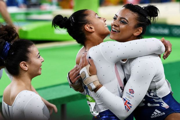 Day four: Ellie and Rebecca Downie hug after competing on the vault during the Artistic Gymnastics Women's Team Final.
