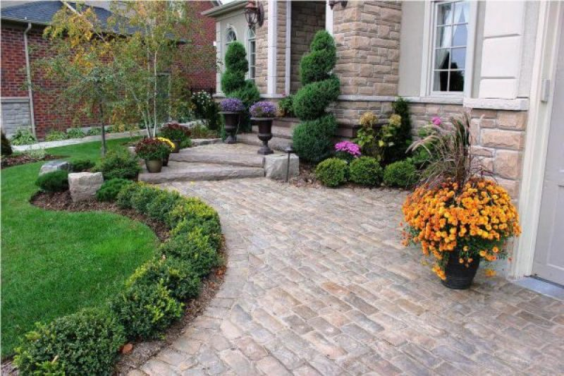 Front Yard Landscaping Ideas - Structured Evergreen Garden Beds with Colorful Planters- harpmagazine-com