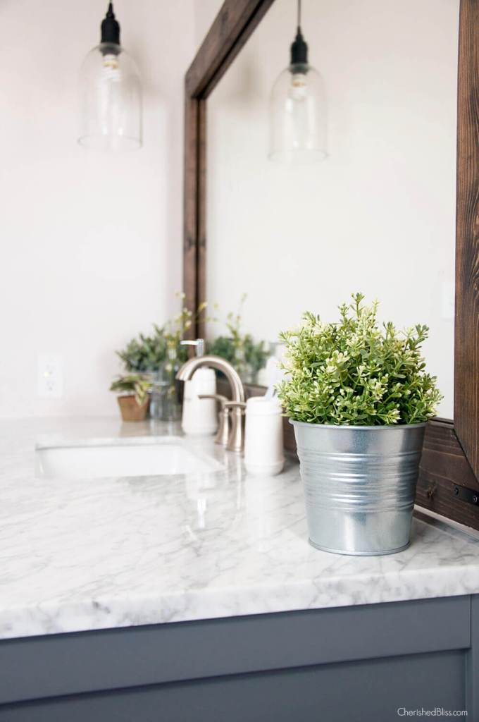 Farmhouse Bathroom Decor Ideas - Metal Bucket Flower Planter Bathroom Decorations - harpmagazine.com