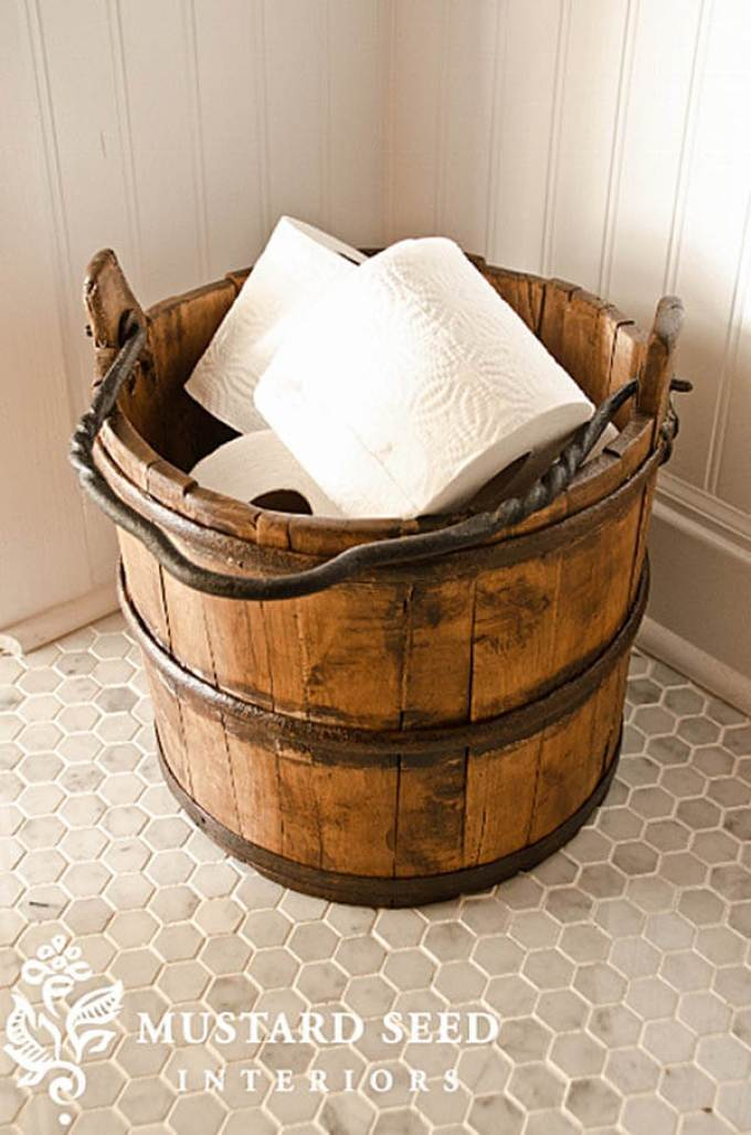 Farmhouse Bathroom Decor Ideas - Wood Bucket Toilet Paper Holder - harpmagazine.com