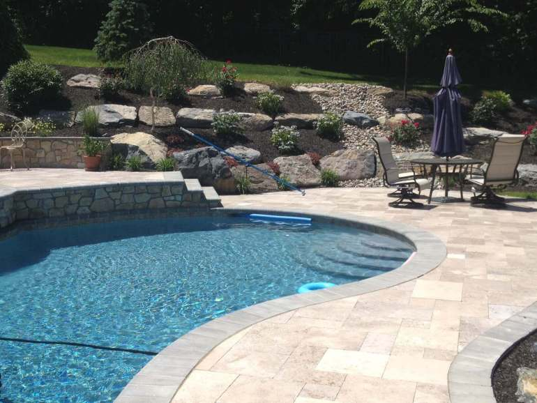 Paver Patio Ideas - Poolside Paver Art - harpmagazine.com
