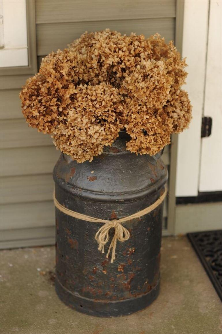 Farmhouse Porch Decorating Ideas - Antique Milk Pail Planter - Harpmagazine.com