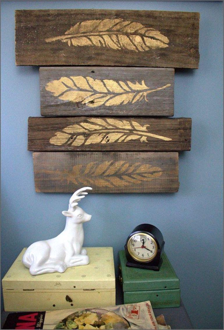 Rustic Wall Decor Ideas - Stenciled Metallic Feathers on Weathered Wood Blocks - harpmagazine.com