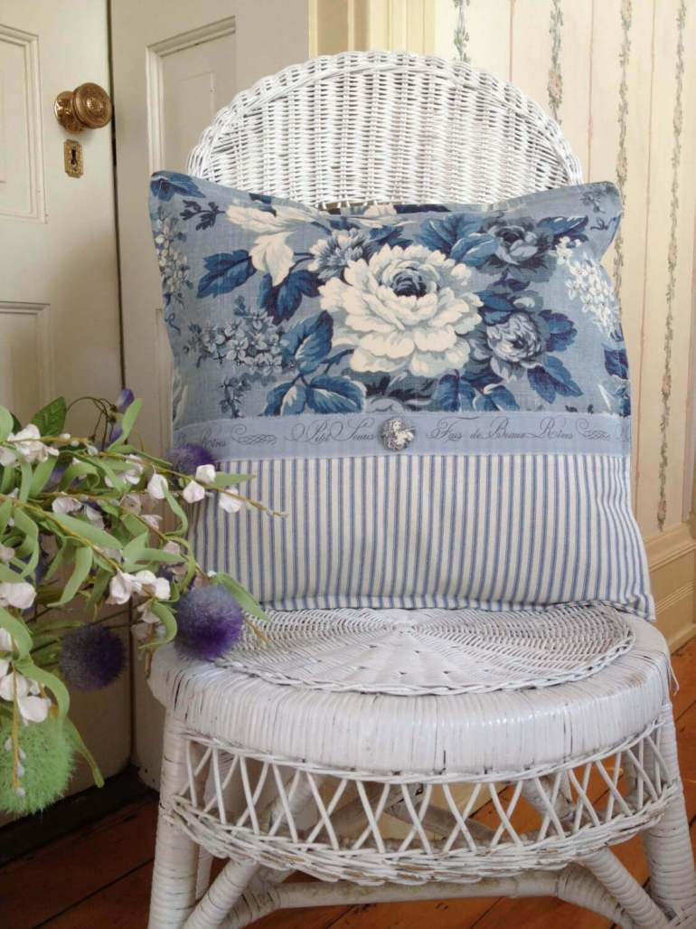 French Country Decor Ideas - White Wicker Chair with Blue Toile Pillow - Harpmagazine.com