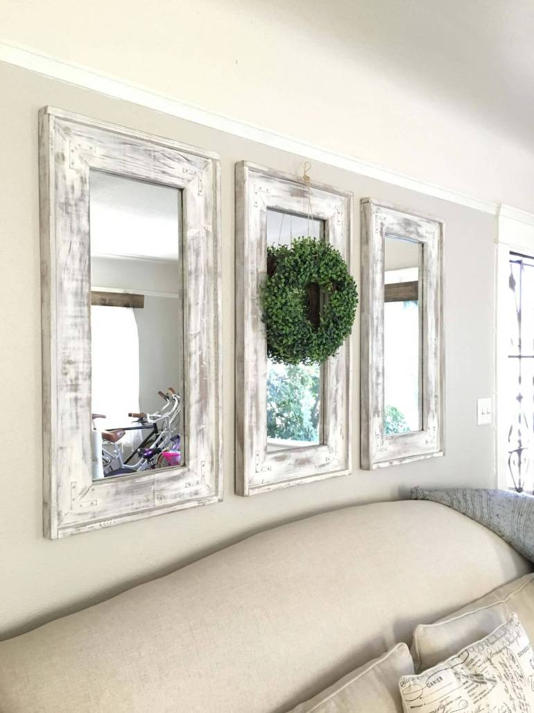 Rustic Wall Decor Ideas - Retrofitted Wall Mirrors with Natural Wreath Accent - harpmagazine.com