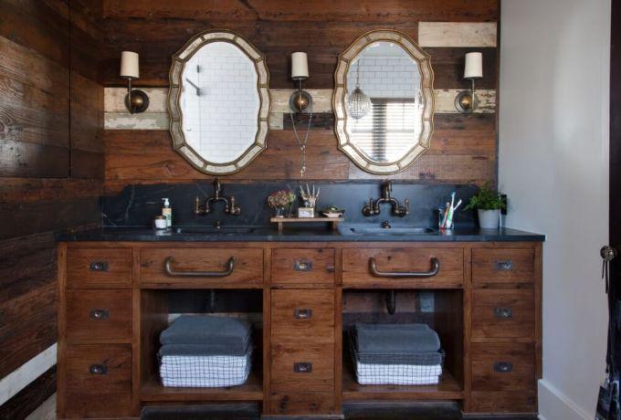Rustic Bathroom Decor Ideas - Dark Paneled Vanity Backsplash with Vintage-style Double Mirrors - harpmagazine.com