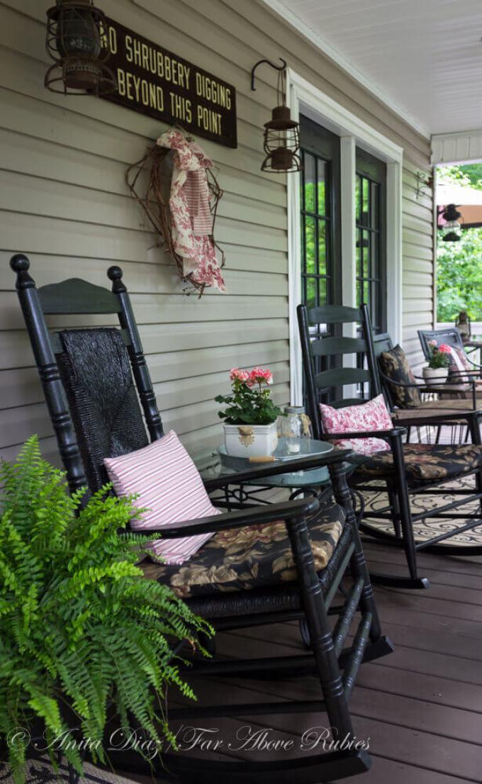 Farmhouse Porch Decorating Ideas - Edward Gorey Inspired Black Rockers - Harpmagazine.com