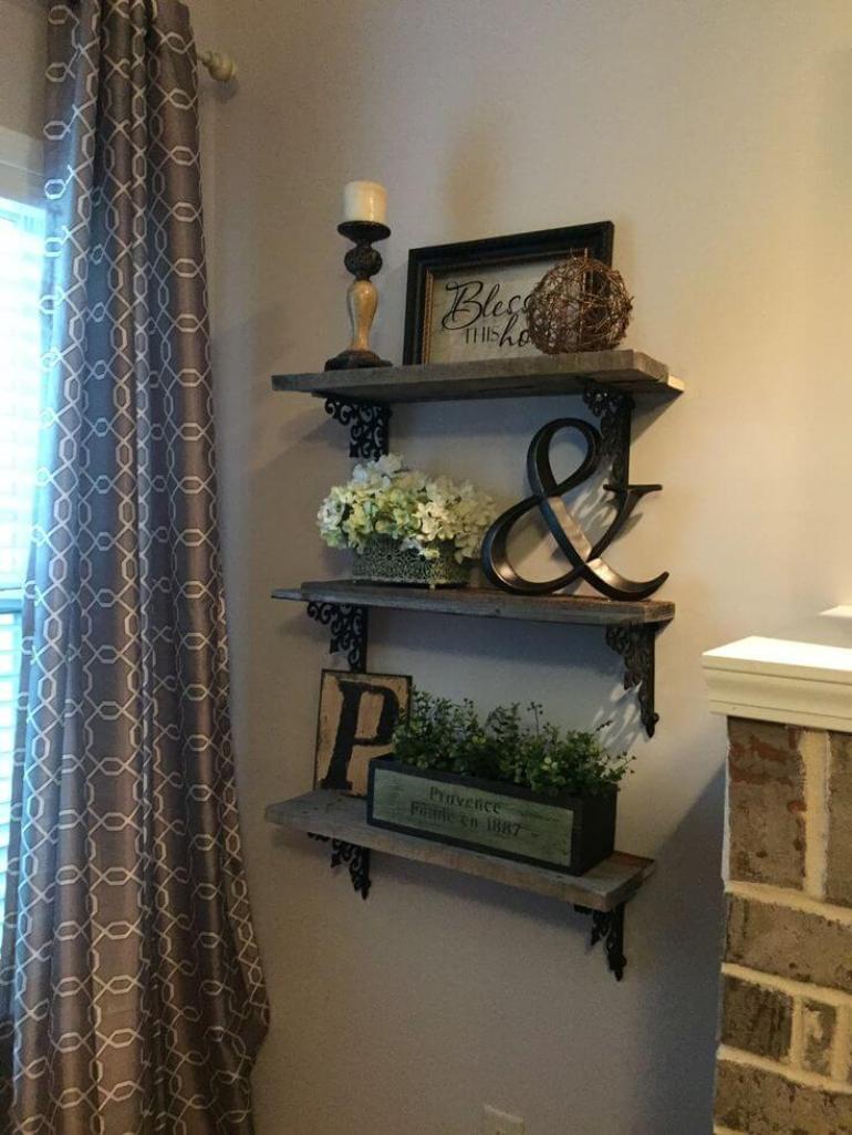 Rustic Wall Decor Ideas - Triple Shelf Display with Wrought Iron Brackets - harpmagazine.com