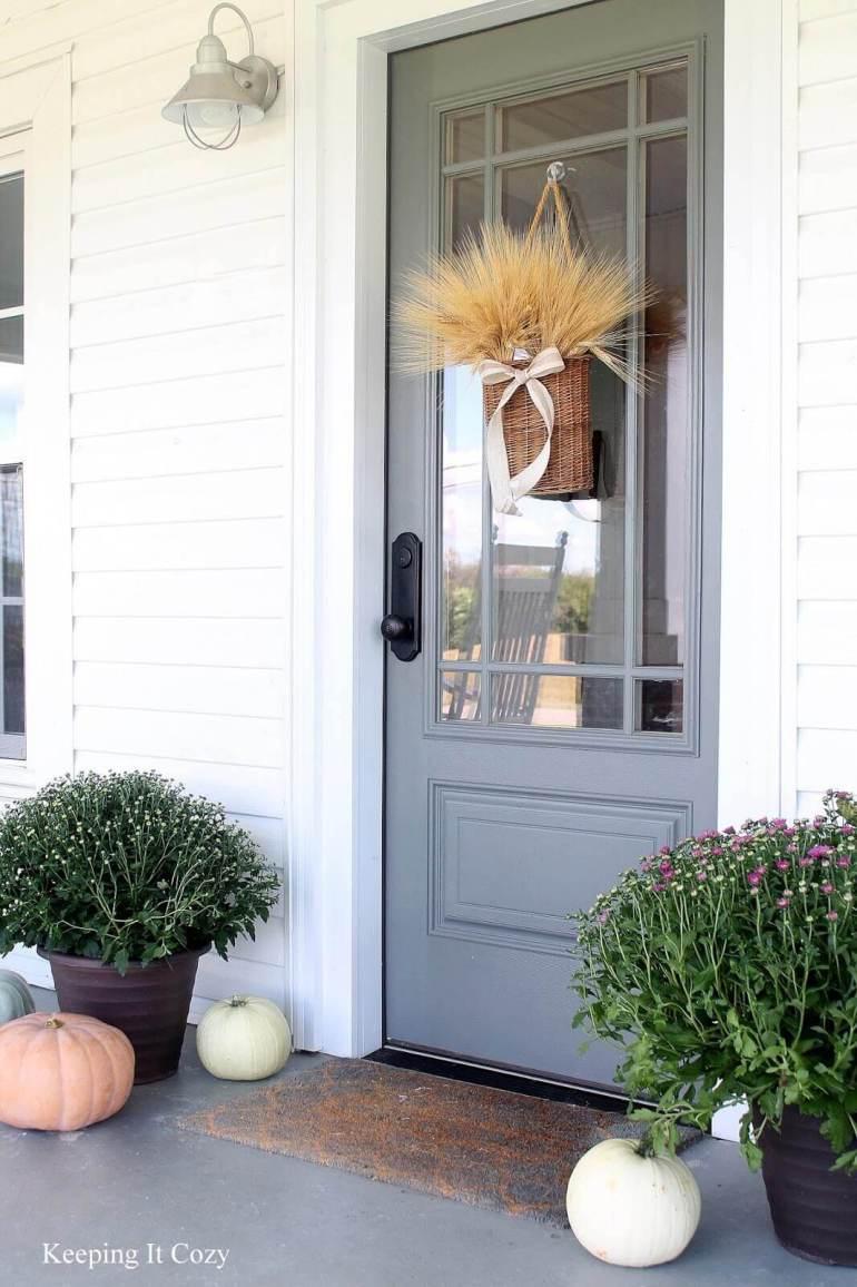 Farmhouse Porch Decorating Ideas - Prairie Estate Robin's Egg Door & Crafted Basket - Harpmagazine.com
