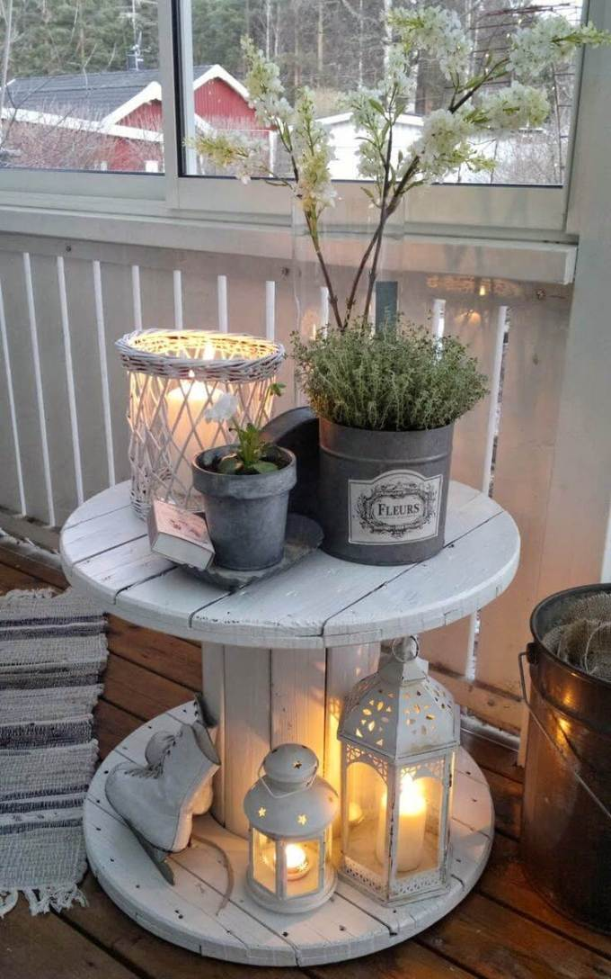 Farmhouse Porch Decorating Ideas - Enchanted Repurposed Spool Table - Harpmagazine.com