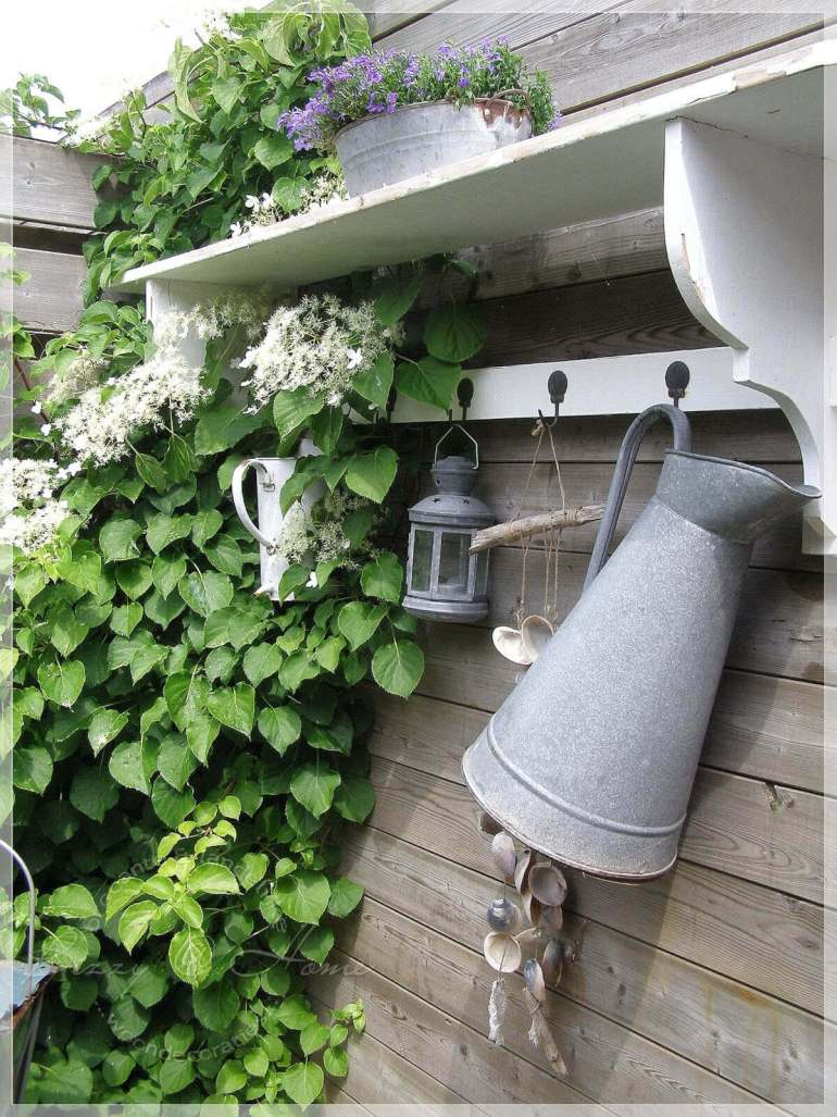 Farmhouse Porch Decorating Ideas - Potter's Shed Rustic Hanging Accoutrements - Harpmagazine.com