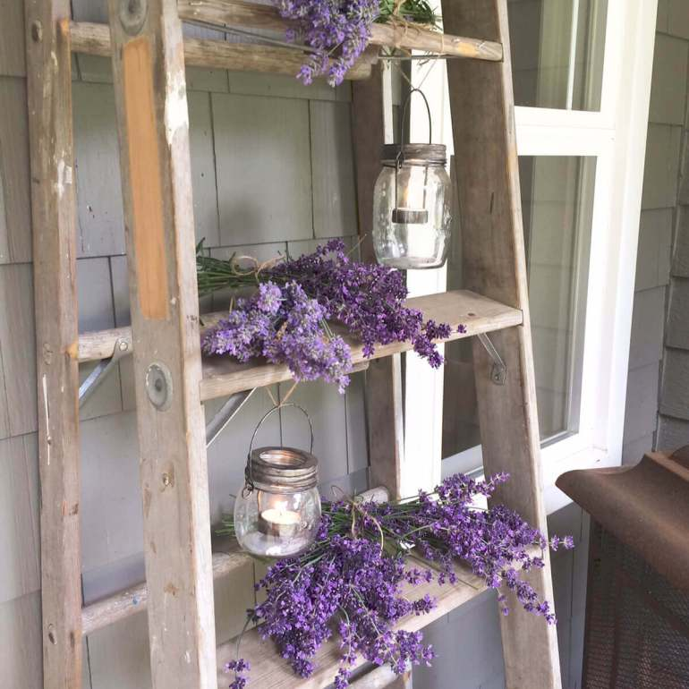 Farmhouse Porch Decorating Ideas - Lavender Province Stripped Ladder With Mason Lanterns - Harpmagazine.com