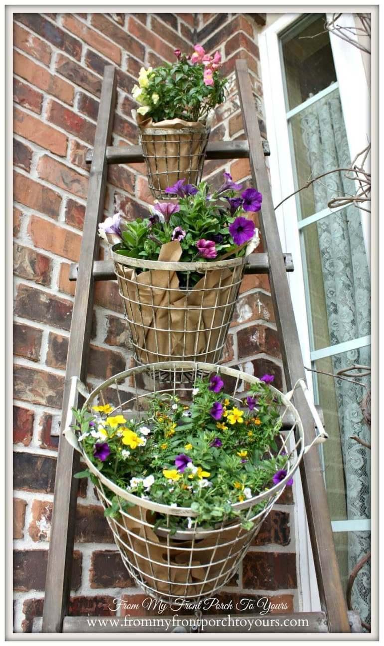 Farmhouse Porch Decorating Ideas - DIY Tiered Wired Egg Basket Planter Display - Harpmagazine.com