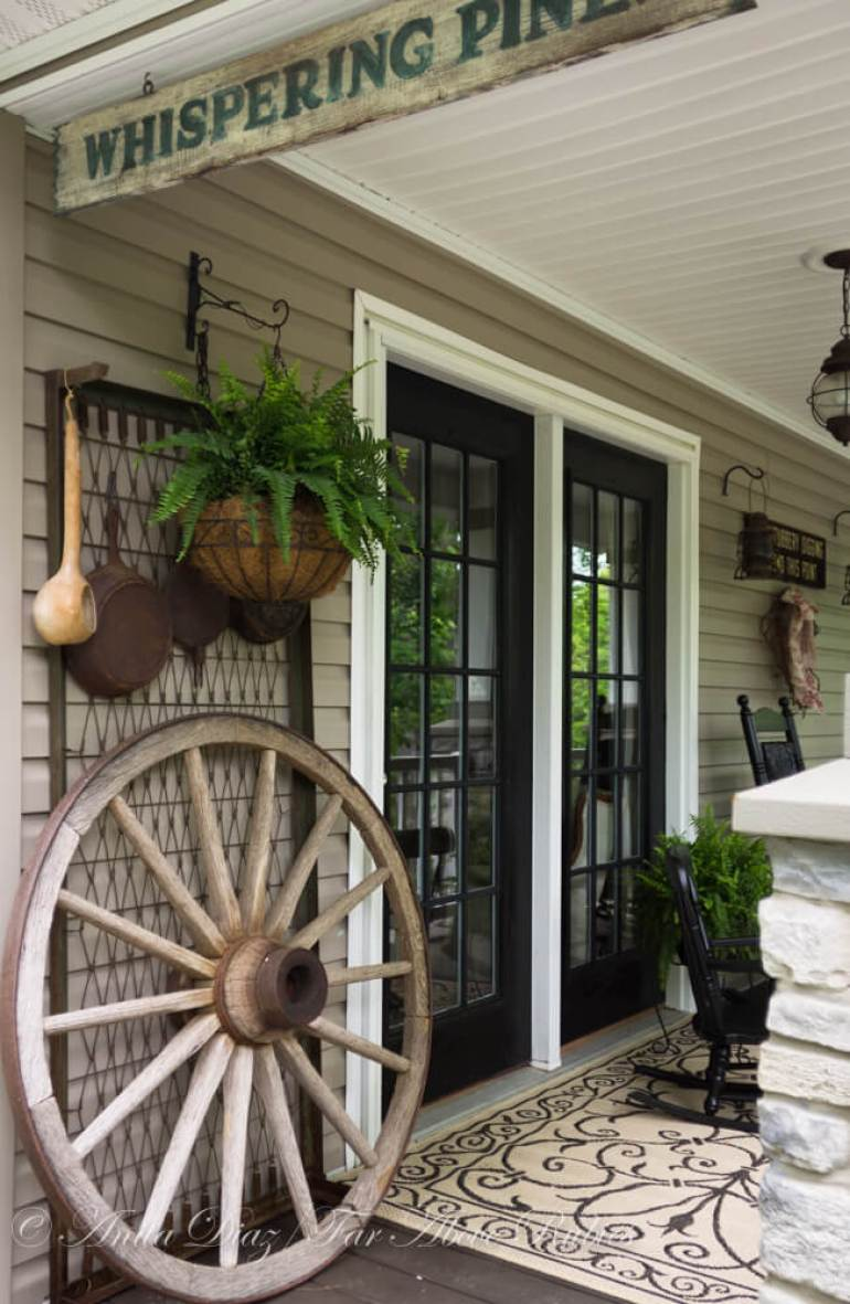 Farmhouse Porch Decorating Ideas - Go West Wagon Wheel & Assorted Hanging Pots - Harpmagazine.com